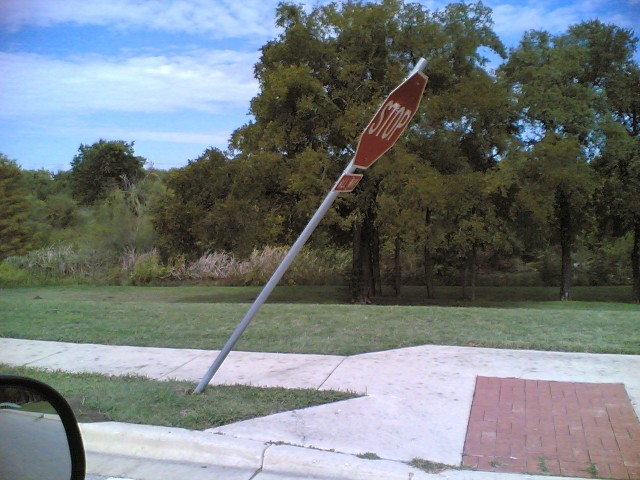 Leaning stop sign