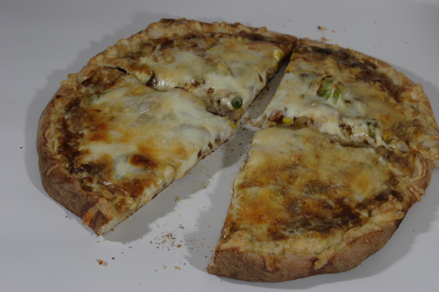cooked Pizza with curry