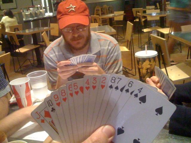 A Tichu hand in a bridge game